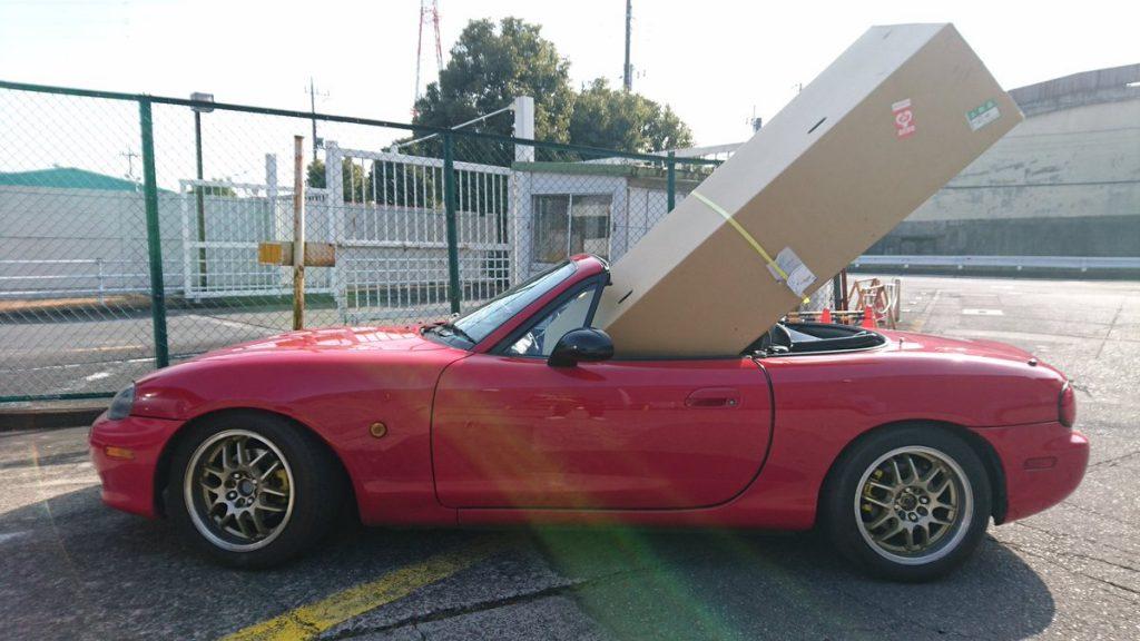 大きな荷物を運ぶならオープンカー
